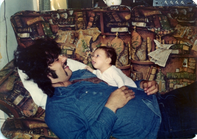 My dad and my sister Jenny on an amazing book couch! 1976